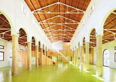 Spanish architects Miquel Mariné Núñez and César Rueda Boné have transformed an abandoned market hall in Aragon into a children's centre