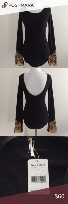 "Free People Thermal Bali Babe Cuff - S Fitted black thermal top with detailed cuff and curved hem. Cuff is embellished with Bali inspired embroidery.  New with tags.  Tag cut to prevent store returns.   Fabric: 59% Cotton 39% Polyester 2% Spandex Approx. length is 26"" in front and 24.5 in back and sleeve length is 29"". Free People Tops Tees - Long Sleeve"