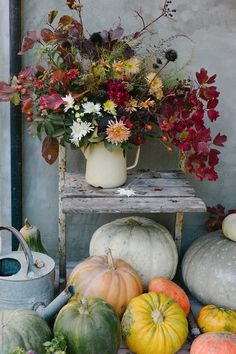 Rustic tools, harvest of pumpkins, and flowers near gray wall Autumn Garden, Grey Walls, Harvest, Rustic, Flowers, Whisper, Pumpkins, Tools, Gray