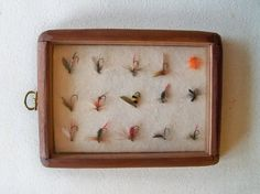 MADE MY OWN VERSION fly fishing lures in a display