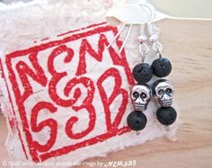 skull with volcanic stones ear-rings by NemSeb