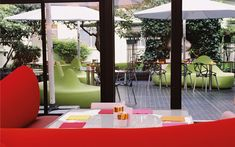 We are a global and creative design studio in Geneva, Tokyo and Beijing. Paris France Food, Indoor Outdoor, Green Sofa, Patio, Square Tables, Garden Trees, Garden Furniture, Hospitality, Exterior Design