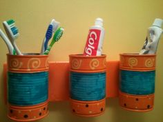 Cute diy for a small kids bathroom. Veggie cans and scrap wood. Great way to keep stuff off small counter.