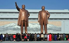 """Bjorn Bergmann """"During our bus trips, there was three guards and they didn't allow us to take any pictures besides what they asked us to shoot, such as monuments."""" North Koreans pay their respects at giant statues of Kim il-Sung and Kim Jong-il Inside North Korea, Life In North Korea, South Korea, North Korea Pictures, Kim Jong Il, World Icon, Bus Travel, North South, Korean War"""