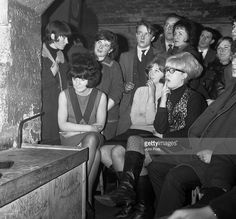 A crowd of young people watching the latest act at the world famous Cavern Club in Liverpool.