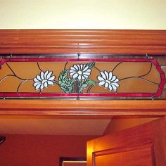 Stained glass transom window, like the idea, would probably do solid color or a couple colors only