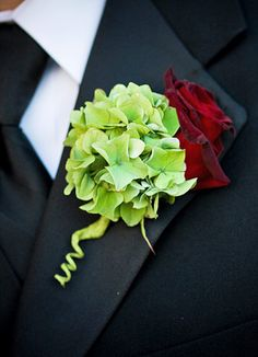 this with a deep purple carnation instead of the rose would be perfect for the grromsmen
