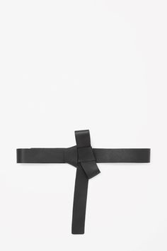 COS - This belt is made from a soft buttery leather with a tied bow detail. Designed to sit at the waist, it closes with two hidden metal pins.