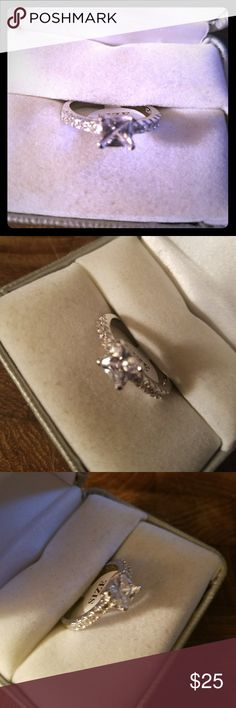 Just in! GORGEOUS ENGAGEMENT RING Please let me know what size you need. If I have it, I'll make you a separate post.   I have ..size 6.5, 7.5, 2 size 9s, one size 10.   Sterling Silver stamped. Gorgeous Engagement/wedding ring.  1 ct center stone in an princess Cut. Channel set czs on both sides of center stone on the band.  Absolutely stunning ring.   New, never worn.  Box in picture is for display purposes only.  Smoke free.  Free gift with purchase. Don't forget to bundle together to…