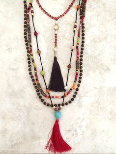A Multi Layer Bohemian Beaded Tassel Necklace that is all in 1 in Fall Earthy colors. You don't need to add anything, and you got an instant effortless updated Bohemian Look. Colorful beads, glass and