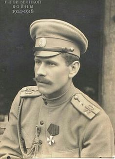 Imperial Russian Army - Staff-Captain with the Order of St. George medal, Imperial Russia's highest military order awarded to officers and generals for special gallantry. Epaulettes with 4 star staff-captain's pattern. Note oval cap badge.  Tunic has center button pattern with indications of shallow scalloped breast pocket flaps. WW1.