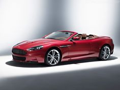 Aston Martin DB9 - I need one in 'I'm on fire Red' and one in 'Dead of Night Black'.