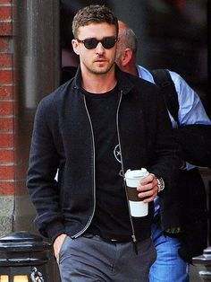 Justin Timberlake grabs a cup of joe while looking suave and rocking trendy rounded shades