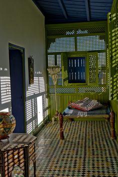 Sleeping porch with lattice, lovely light, rug