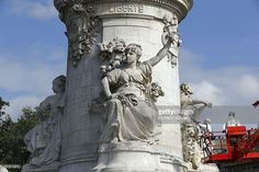 City workers clean the pedestal of the Marianne monument at Place de la Republique in Paris, on August 10, 2016, which had become a makeshift memorial in tribute to the victims of the recent attacks of the last two years. The City of Paris began on August 1, 2016 a large cleaning operation of the statue in the center of the square of the Republic, whose pedestal has become after each terrorist attack where people deposited flowers, candles or poems in tribute and support. Archivists of the…