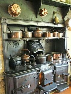 Old Victorian kitchen with a large stove and a collection of old pots, pans, and kettles. Wood Stove Cooking, Kitchen Stove, Old Kitchen, Country Kitchen, Vintage Kitchen, Kitchen Decor, Kitchen Ideas, Kitchen Wood, Kitchen Supplies