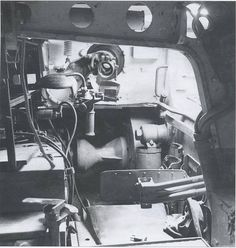 Inside Tiger I A great view of the radio operator's position from the loader's position. The emty mount for the MG 34 and its sight are also visable. So much to look at.