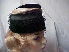 Black velvet cloche hat with netting and circled with by designer2, $24.00