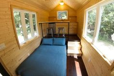 Man Builds 160 Sq. Ft. Studio Tiny House--Bed pulled out...