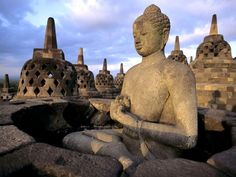 The 1,200-year-old Borobudur temple is home to hundreds of Buddhist statues. Indonesia.
