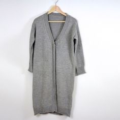Grey long sweater cardigan Brand new. This year's hottest trend-oversized long cardigan. Best deal ever because this is a very popular brand's clothing but directly from the factory without putting tags on so the price is only 1/3 of the original. The pockets are still sealed. Please click off the buttons but don't pull them especially with lots of strength.  Size OS fitsXS-M Sweaters Cardigans