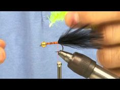 Tying a Black and Green lure | www.fishtec.co.uk - Kieron Jenkins shows how to tie a black and green lure, with an additional gold head which adds movement and colour to the fly.     Black and green seems to be the ULTIMATE in fish catching combinations, winning many 'big fish' trophies and Trout Masters Competitions.