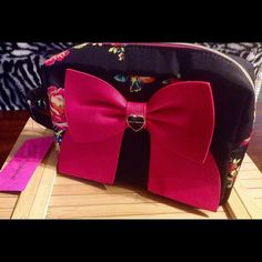 HOST PICK 9-26-16  Brand New Betsey Johnson Side handle, enamel bow. Small pocket inside as well as an inside zippered pocket. Super cute black and multicolored bag. Betsey Johnson Bags Cosmetic Bags & Cases