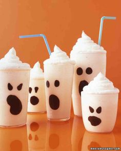 Boo-Nilla Shake... Make the faces with melted chocolate painted inside the glass.  A ghostly white vanilla milk shake is topped with whipped cream!