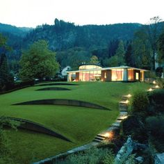 Villengarten by Rainer Schmidt Landschaftsarchitekten  An ingenious way of reducing the slope of the garden, making the lawn more usable.