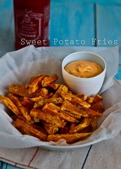 Amazing Sweet Potato Fries! Soak in water while the oven is pre-heating, shake in cornflour and flavoured salt and BAKE.