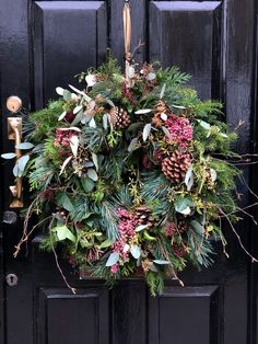 love this rustic christmas wreath with fir, pine cones, eucalyptus, poink peppercorns and twigs by The Real Flower Company. click through for inspiring DIY Christmas wreath ideas you'll love to try wreaths Make a contemporary Christmas wreath Christmas Wreaths To Make, Christmas Flowers, Holiday Wreaths, Rustic Christmas, Christmas Crafts, Christmas Decorations, Christmas Christmas, Artificial Christmas Wreaths, Christmas Island
