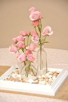 Centerpiece, this looks simple enough. A frame, spray painted to whatever color you want, some filler like rocks or marbles (or confetti!) and vases from the dollar store #dollar_store_apartment