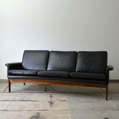 black leather + wood sofa