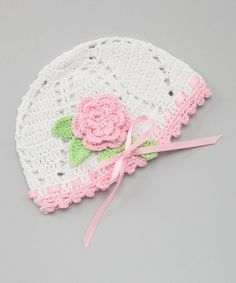 Take a look at this White & Pink Crocheted Flower Beanie - Infant by Pink and Blue Knitwear on #zulily today!