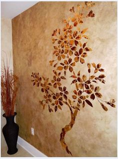 Faux finished wall with stenciled tree