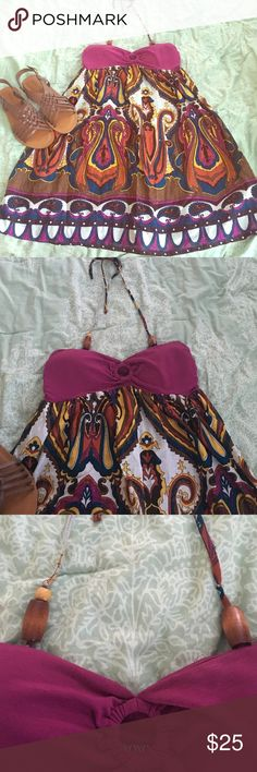 Cute boho dress Very cute boho halter dress. Purple top and patterned on bottom. Dress is halter style. Top is very sturdy like a bandeau top. Has small pads sewn in (but not visible) so you would not have to wear bra. Bottom is lined. XOXO brand. EUC, worn maybe once or twice. Halter string is missing one bead on right side as pictured XOXO Dresses