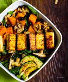 Butternut Bliss Fall Salad with maple chipotle tofu, butternut squash, cranberries, walnuts, and avocado.
