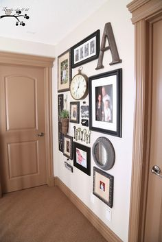 Love the mix of signs and clock with the pictures: Lookie What I Did: Our Picture Gallery Wall