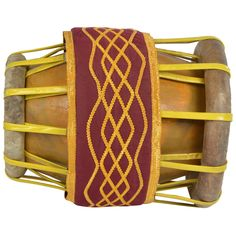The thavil or tavil is a barrel shaped drum from South India. It is used in temple, folk and Carnatic music, often accompanying the nadaswaram.