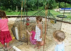 The children discovered that if they wove the bamboo garden stakes through this plastic garden mesh a few times before pushing the stake into the sand, the stakes will hold the mesh in place. Instant walls.