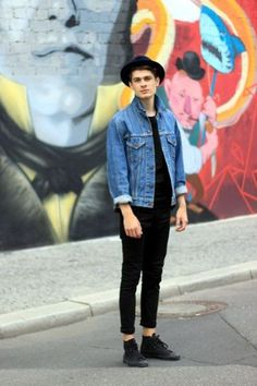 black jeans, a black tee, a denim jacket and black converse