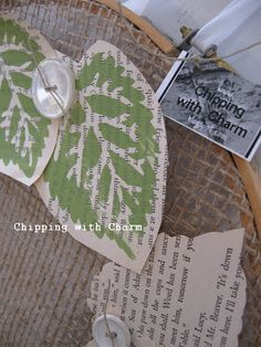 leaves stamped on book pages, cut to shape