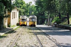 Two No' 3 trams as they pass each other on a inclined street, Iasi, Romania
