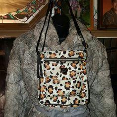 SALEAuthentic Betsey Johnson Crossbody Bag Nylon Mushroom Multi Xbody bag with Leopard Print. Complete zipper closure, inside zipper, Snap front pocket 10 length X9 Width. Betsey Johnson Bags Crossbody Bags