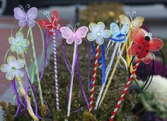 These would be a fun craft in the butterfly and flowers for the themed party