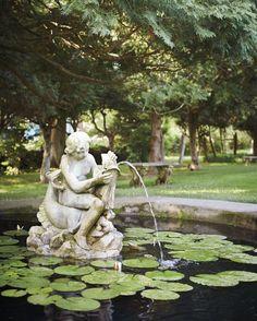 The pool garden was completed around 1905 and is framed by hemlock hedges and arborvitae.