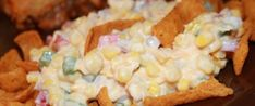 Frito Corn Salad One of our favorite snacks. We eat it as a dip instead of putting the fritos in the salad. I Add ranch dressing to the mircle whip. Corn Salad Recipes, Corn Salads, Appetizer Recipes, Appetizers, Dip Recipes, Snack Recipes, Frito Corn Salad, Fritos Salad, Tasty