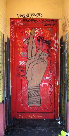 Artist: Know Hope - Fingers crossed - LA, USA - 2008...door street Art