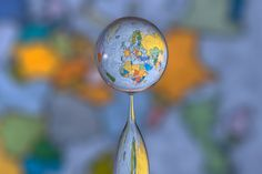 Refracted world map inside a water droplet.
