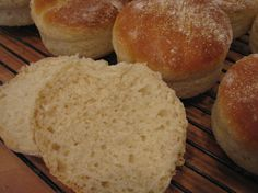 While searching the web looking for Schlotzskys Sourdough Bread recipe I came across this on King Arthurs site.    I think its very close to the roll that they use on their original muffaletta sandwich.   They are scrumptious and so easy to make!    Theyre somewhere between a roll and an english muffin.    Note that  their direction require baking in english muffin rings (or similar).